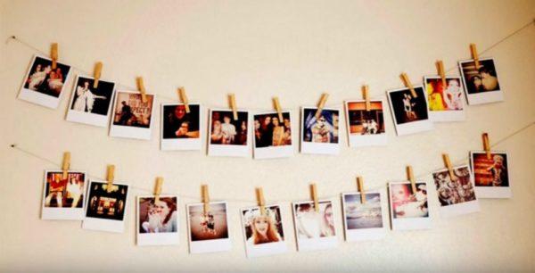 Шпагат, распечатанные фото и прищетки – вот рецепт фотогирлянды.