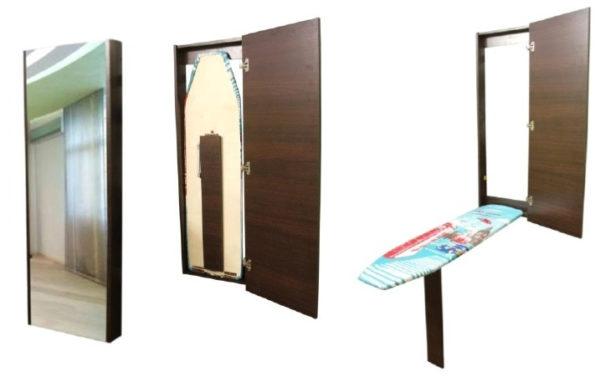 Гладильная доска, встроенная в шкафчик за зеркалом.