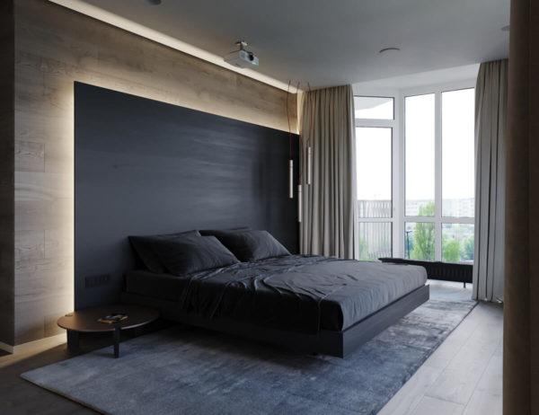 «Парящая» кровать, подсветка на стене и раздвигающиеся от пульта шторы – мужской технологичный стиль.